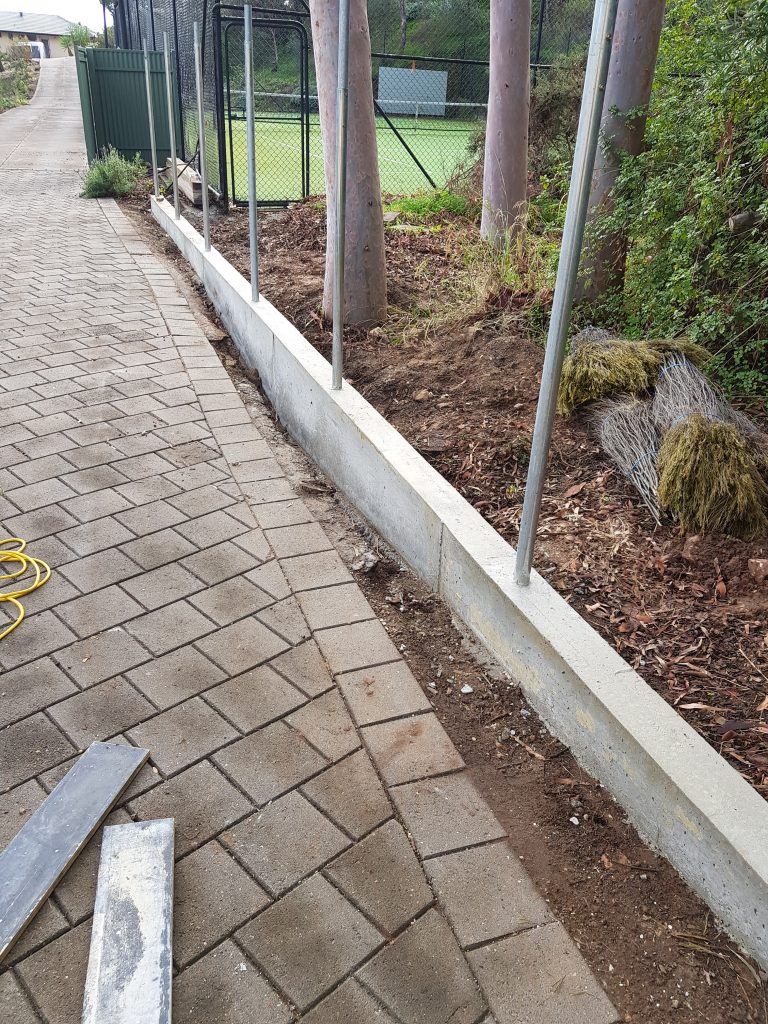 Raising fence height using reinforced concrete base.